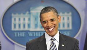 US President Barack Obama smiles as he m