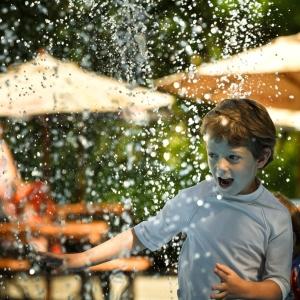 Boy splash water park