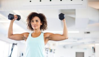 Young Woman Weightraining at the Gym