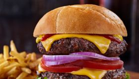 Double Staked Cheese Burger with Beer and Fries - Vertical