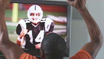 CU SHAKY Man watching sports on TV, Phoenix, Arizona, USA