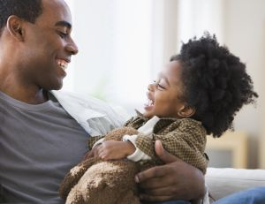 African American father smiling at son